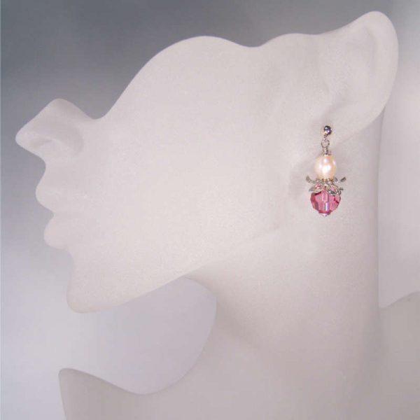 Rosa Blütenohrringe mit Kristall und Perle